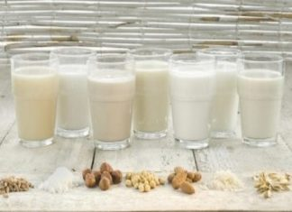 Various types of lactose-free milks in glasses