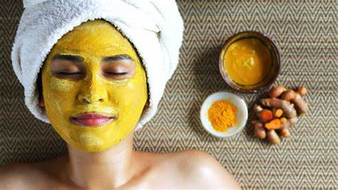 Skin lightening with turmeric